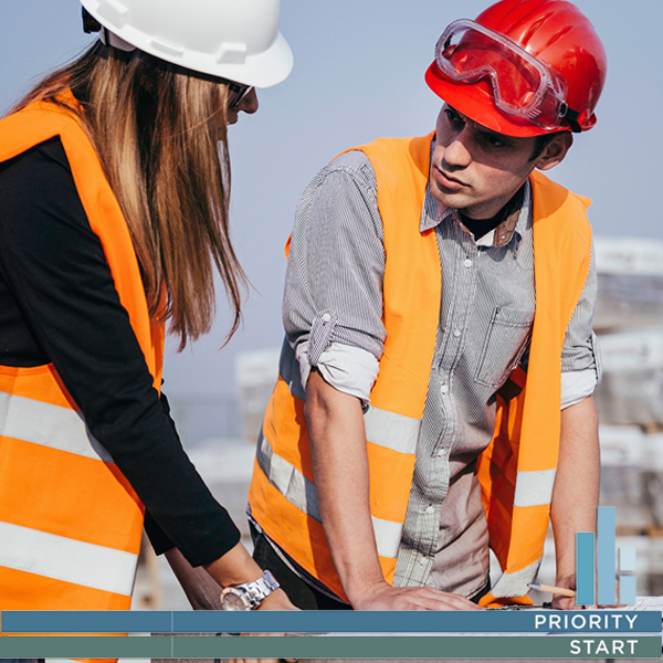 A female and male contractor on a building site