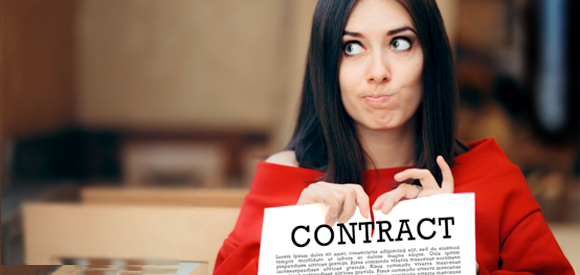 A woman tearing up a contract.