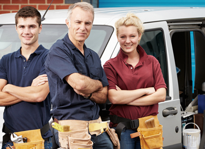 An employer, with two apprentices.