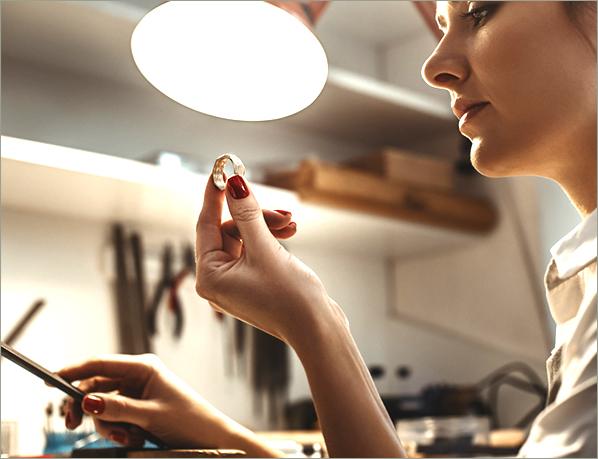 A jewellery design apprentice at work.