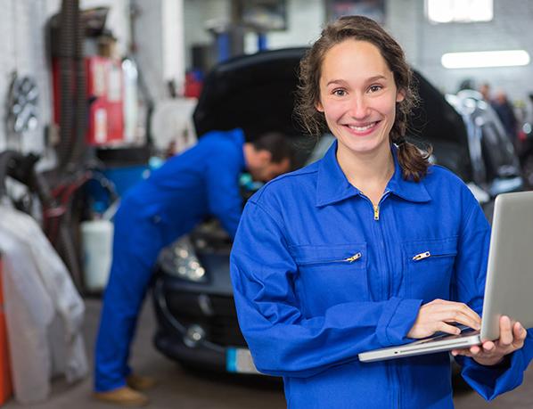 A female automotive apprentice at work.
