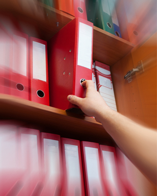 A person reaching for a file.