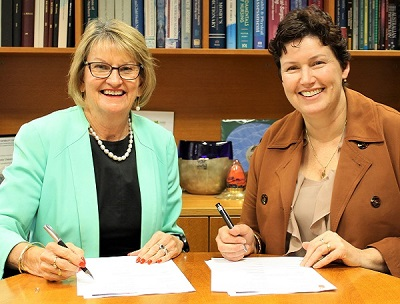 Curtin University's Professor Jill Downie, and RRR Network CEO Jackie Jarvis signing the MOU on Wednesday 19 September.
